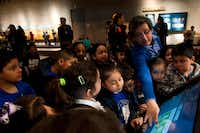 Jorge Caepena, a first-grade teacher at Pershing Elementary School, led his students through one of the interactive models at the Perot Museum.