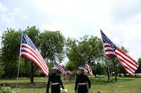 Sgt. Kyle Riley (left) and James Lafarlette, members of the Marine Corps band, walk into the Cedar Hill Pet Memorial Park.(ROSE BACA - neighborsgo staff photographer)