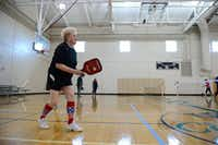 Kay Seamayer plays a round of pickleball at the Cedar Hill Recreation Center. Seamayer serves as ambassador-at-large in the Dallas area for United States of America Pickleball Assocation.( ROSE BACA/neighborsgo staff photographer )