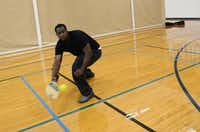 """Kieth Robinson reaches to paddle the ball during a round of pickleball. A former football player at South Oak Cliff High School, he plays pickleball most Friday mornings. """"It's good for exercise and cardio, period. It gets your heart pumping,"""" he said.( ROSE BACA/neighborsgo staff photographer )"""