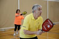 Michael Dalby and Linda Lightfoot play a round of pickleball at the Cedar Hill Recreation Center on Jan. 31, 2014. In late 2012, the recreation center opened two pickleball courts, and an additional court within the last month. Now a group of senior citizens frequently gather to play the sport.( ROSE BACA/neighborsgo staff photographer )