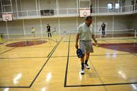Ed Guancial gets ready to serve in a game of pickleball at the Rowlett Community Centre.(Rose Baca - neighborsgo staff photographer)