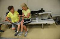 Pickleball players Sarah Smith (left) and Casey Erickson chat in between games at the Rowlett Community Centre.Rose Baca  -  neighborsgo staff photographer
