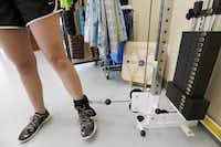 Haley Holmes, 16, lifts a five pound weight attached to her ankle during a physical therapy session. Holmes, a high school athlete, has been receiving physical therapy treatments for about three months.( Photo by Brandon Wade  -  special contributor )