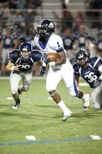 Plano West running back Sotonye Jamabo (1) runs the ball during a Sept. 27 game against Flower Mound. Plano West won 41-6. After a bye week, the team will play McKinney Boyd at 7:30 p.m. Friday at Plano's John Clark Stadium.