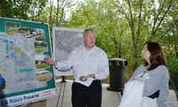 <TypographyTag1>Robin Reeves</TypographyTag1> (left), chief park planner for the city of Plano, discusses plans and updates to Oak Point Park and Nature Preserve with resident Tammy Welch during one of two neighborhood meetings held last week. Welch is part of a group worried that a two-day music festival planned to debut in the park in the spring could damage a more than seven-acre blackland prairie remnant.Staff photo by NANETTE LIGHT