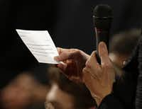 An audience member reads from a printed question during the second presidential debate at Hofstra University Tuesday in Hempstead, N.Y.