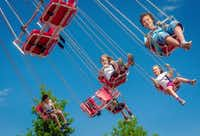 Swings delighted children on the park's opening day.( Michel Caumes  -  The Associated Press )