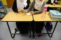 Students build a rocket out of a straw. Principal Qadeer Qazi and Richardson Mayor Laura Mackza said the school fills an education void for local Muslim girls.(Rose Baca - neighborsgo staff photographer)