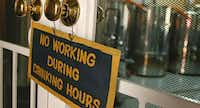 A sign in the front of the bewing room at Four Bullets Brewery welcomes guests to relax and enjoy the brewery.(Nathan Hunsinger - Staff Photographer)