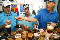 Ken Staas, (from left) Jeff Duryea and Chuck Jaggers collect their beers at Four Bullets Brewery.(Nathan Hunsinger - Staff Photographer)