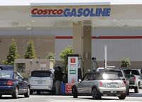 The Costco sign meant two things to our road-trippers: a deal on gasoline and healthy meals on a budget.( Paul Sakuma  -  The Associated Press )