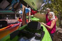 Marie and John Koski admire some new kayaks at L.L. Bean while on vacation in Freeport, Maine. The Koskis are part of a growing group of vacationers 50 and older who are finding creative ways to travel economically.( Craig Dilger  -  The New York Times )