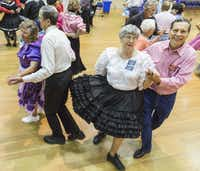 Dancers at the Dixie Chainers Square and Round Dance Club at the senior center in Farmers Branch.