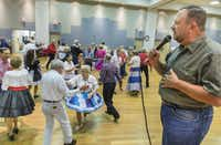 Vernon Jones calls the dance at the Dixie Chainers Square and Round Dance Club at the senior center in Farmers Branch.