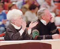 Former Texas Gov. Ann Richards watches a University of Texas women's basektball game with author Bud Shrake Wednesday, Jan. 25, 1995, in Austin, Texas.
