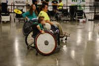Bryce Winters, 8, plays quad rugby during the free skate at a two-day BMX and wheelchair motocross event at the Irving Convention Center.(Rose Baca - neighborsgo staff photographer)