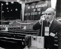 Robert Strauss, chairman of the Democratic National Committee, checks out one of the delegates' telephones at the Kansas City Auditorium, site of the Mid-Term Democratic Party Conference. The telephones connect the delegations with the speaker's podium.( ASSOCIATED PRESS )