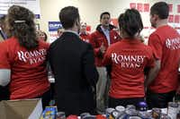 Republican vice presidential candidate, Rep. Paul Ryan, R-Wis., speaks to volunteers and supporters at a campaign office in Hudson, Wis., Tuesday, Oct. 30, 2012, where volunteers were collecting relief supplies. (AP Photo/Mary Altaffer)(Mary Altaffer)