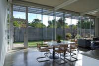 Architect Ron Wommack designed the living room in his residence to have plenty of light. The cement wall creates a modernisty courtyard with plenty of privacy.
