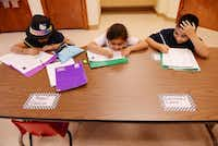 Students (from left) Brenda Arredondo, 7; Alexandra Guzman, 7; and Angel Rincon, 8; do their homework during the after-school program at Wesley-Rankin Community Center in West Dallas. The center is re-examining its programs and coming up with new ways to try to bring stability to West Dallas children and adults.( ROSE BACA )