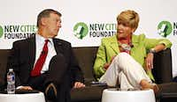 Dallas Mayor Mike Rawlings listens as Fort Worth Mayor Betsy Price talks on a panel during the New Cities Summit at Winspear Opera House in Dallas. (2014 File Photo)
