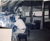 An Irving Archives photo shows Raymond Story (standing) in the U.S. Navy in 1944.