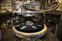 A machine makes a microgroove impression on a vinyl record at A&R Records. (Rose Baca/Staff photographer)