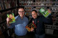 Kenneth Denson (left) and Gabriel Mendez, owners of Red Pegasus Games and Comics, show off some of their products in their Oak Cliff store. (Jae S. Lee/The Dallas Morning News)