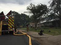 Dallas firefighters dealt with two house fires on Regent Drive near Webb Chapel Road Tuesday morning (Rose Baca/Staff photographer)