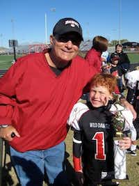 Rick Collins (left) of Wylie now spends most of his time cheering for his grandkids, such as Clayton Collins, at their sports games. Rick Collins largely credits his family to his recovery after the Vietnam War.Photo submitted by LINDA COLLINS