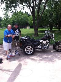 Rick Collins (left) sold his motorcycle -- retrofitted so the gears could be changed with a thumb switch -- this summer to Ryan Newell, a double amputee Afghanistan veteran.(Photo submitted by LINDA COLLINS)