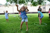 Evelina Kalenik, 5, Hula Hoops during summer camp at River of Life, an Evangelical Christian church that caters to Russian-speaking immigrants and operates out of Hunters Glen Baptist Church in Plano. River of Life is just one of six international churches meeting at Hunters Glen Baptist Church.(ROSE BACA - neighborsgo staff photographer)