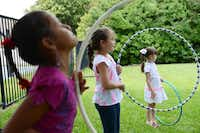 Sophia Latham, 7, (middle) plays during summer camp at River of Life.ROSE BACA - neighborsgo staff photographer