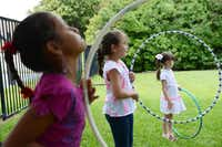 Sophia Latham, 7, (middle) plays during summer camp at River of Life.(ROSE BACA - neighborsgo staff photographer)
