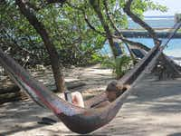 Spending a day  on Little French Cay can mean doing little more than finding a quiet hammock for reading.June Naylor