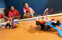 Felix Reeves, 10, and Maya Mcintyre, 9, were happy campers as they raced the robots they made during Robots-4-Everyone.