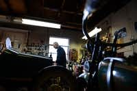 Mack, 91, moves equipment around in his garage in Dallas. Mack is a vintage car collector and retired electrical mechanic and served as a tank mechanic in General George Patton's 13th Armored Division during World War II.Photos by ROSE BACA