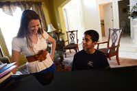Roman Scott, 11, gets instruction from his piano teacher, Megan Maxwell, at his home in Cedar Hill. Scott was diagnosed with autism when he was 18 months old and by age 4 his symptoms were cured with the help of his mother Elizabeth who worked with him several hours a day since the diagnosis. Now, Roman, a  student at Life School in Red Oak, recently earned perfect scores on all three STAAR tests.