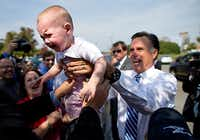 Mitt Romney was greeted by supporters Thursday at a rally in Fishersville, Va.