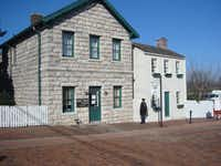 Samuel Clemens' boyhood home, right, is one of eight historic properties in the Mark Twain Boyhood Home & Museum complex in Hannibal, Mo.