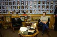 """Docent Deloris Ballard sits among the """"wall of honor"""" featuring Royse City service members from the Civil War to present day at the Zaner Robison Historical Museum. The museum, which opened in 2008, now faces a cloudy future as the city works to preserve its past.Photos by ROSE BACA"""