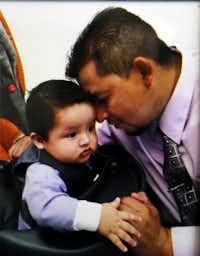 Rubén García Villalpando is shown, shortly before his death, in this file photo with his son Abdiel.