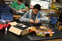 R.L. Turner High School freshman Jonathan Perez makes adjustments to a radio-controlled car during Student Racing Challenge class, which teaches students engineering and science principles through hands-on projects involving or related to radio-controlled cars.( Photo by RUTH HAESEMEYER  -  Special Contributor )