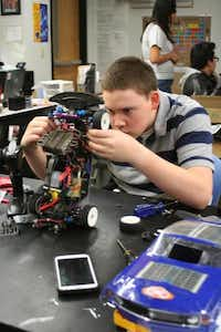 Bullis prepares a radio-controlled car for a lap around the track during Student Racing Challenge class.