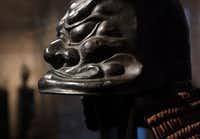 An ancient helmet with a sculptured design at the Samurai Collection( File 2013  -  Staff Photo )