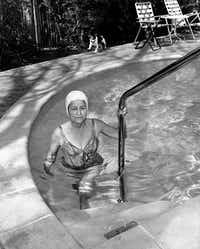 PUBLISHED February 13, 1963 - In freezing weather Federal Judge Sarah Hughes, 66, keeps fit with swims in her heated pool at 3816 Normandy.  Since the fitness fad she's been swimming 50 lengths a day rather than her customary 20.(BILL WINFREY/Staff Photographer)