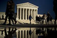Visitors file past the Supreme Court building in Washington. With the death last weekend of Justice Antonin Scalia, the court is down to eight members -- four appointed by Republican presidents and four appointed by Democrats. (Andrew Harrer/Bloomberg News)