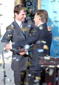 Tom Cruise, shown with the Church of Scientology's David Miscavige during the opening of a new church in central Madrid, is on of the celebrities covered in author Lawrence Wright's new examination of Scientology.