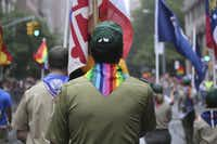 FILE-- Boy Scouts participate in New York City's annual gay pride parade, June 28, 2015. The Boy Scouts of America voted on Monday July 27, 2015, to end its blanket ban on gay leaders, but the policy will allow church-run units to pick leaders who agree with their moral precepts. (James Estrin/The New York Times)